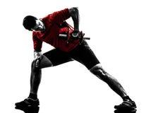 Силуэт тренировки работая веса человека Стоковое Фото