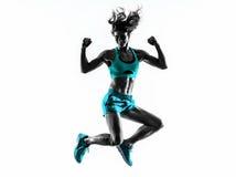 Силуэт тренировок фитнеса женщины скача Стоковые Изображения