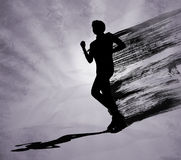 Силуэт черноты человека бегуна Стоковая Фотография