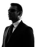 Силуэт человека агента телохранителя безопасностью секретной службы Стоковые Фото
