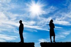 Силуэт человека и женщины в ссоре Стоковые Фото