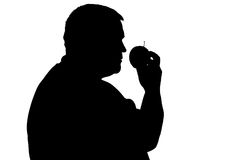Силуэт человека с избыточным весом с яблоком в его руке Стоковая Фотография RF