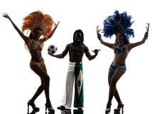 Силуэт человека танцора и футболиста самбы женщин Стоковое фото RF