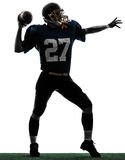 Силуэт человека футболиста защитника американский бросая Стоковые Фото