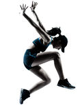 Силуэт jogger бегуна женщины скача Стоковое Фото