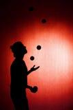 Силуэт juggler Стоковое Изображение RF