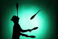 Силуэт juggler Стоковые Изображения RF