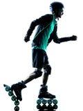Силуэт Rollerblading конькобежца ролика человека встроенный Стоковая Фотография