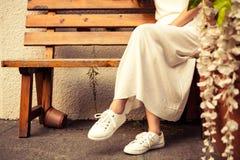 Сидя девушка Стоковые Изображения