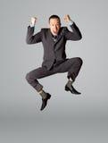 скакать бизнесмена счастливый стоковое фото