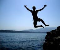 Скакать в озеро Стоковые Изображения RF