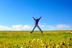 Скакать молодого человека Стоковые Фото