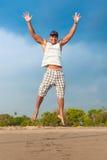Скакать молодого человека Стоковая Фотография