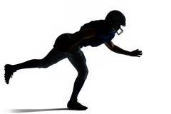 Скакать футболиста силуэта американский Стоковая Фотография
