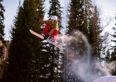 Скакать Snowboarder Стоковая Фотография