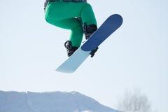 Скакать Snowboarder Стоковое фото RF