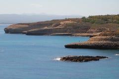 Скалистое морское побережье Порту-Torres, Италия Стоковые Изображения