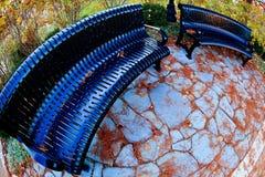 Скамейки в парке Стоковая Фотография RF