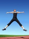 скача женщина стоковое изображение