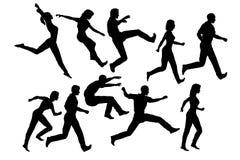 скача силуэты людей Стоковые Фотографии RF
