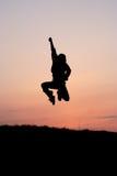 скача силуэт человека одного Стоковое Фото