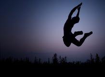скача силуэт Стоковое Изображение