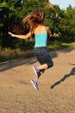 Скача ourdoor девушки Стоковое Изображение