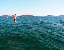 Скачка потехи в море Стоковое фото RF