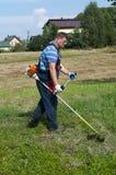 скашивание травы Стоковые Фотографии RF