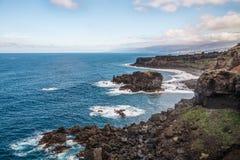 Скалистое побережье около Ла Rambla Сан-Хуана de Стоковое Изображение