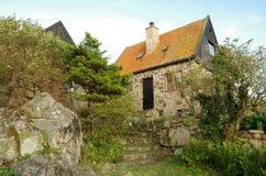 Скалистый дом на Christianso Стоковое фото RF