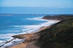 Скалы и пляж взморья Стоковые Фото