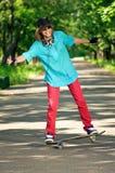 скейтборд девушки подростковый Стоковая Фотография
