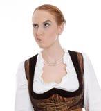 Скептичная женщина в dirndl - дурном глазе стоковое изображение