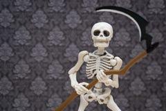 Скелет и коса Стоковое Фото