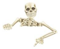 Скелет хеллоуина указывая вниз Стоковая Фотография