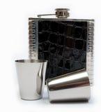 Склянка и чашки вальмы с белой предпосылкой Стоковая Фотография