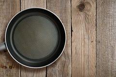 Сковорода на древесине Стоковое фото RF