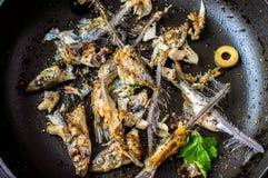 Сковорода с рыбами остатков Стоковая Фотография
