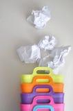 Скомканная бумага распространенная вне от красочных ящиков Стоковая Фотография