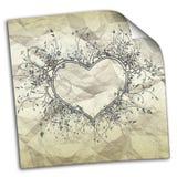 скомканная бумага с чертежами сердец Стоковое Фото