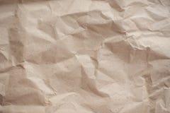 Скомканная коричневая текстурированная старая бумага, стоковое фото