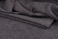 Скомканные предпосылка и текстура ткани Стоковые Изображения
