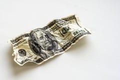 Скомканный 100 долларов на белой предпосылке Стоковая Фотография RF
