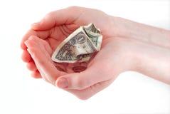 скомканный доллар вручает женщину удерживания Стоковое Изображение