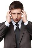 Сконцентрированный бизнесмен имеет некоторые проблемы Стоковая Фотография