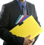 скоросшиватели цвета бизнесмена над белизной Стоковые Фотографии RF