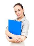 скоросшиватель комода дела предпосылки голубой она изолировал давления к белой женщине Стоковое Фото