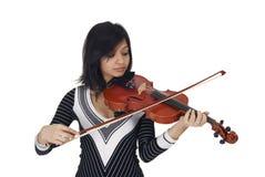 скрипка игрока серьезная стоковое фото