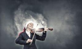 Скрипка игры женщины Санты Стоковые Изображения
